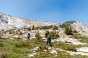 Backpackers take the John Muir Trail in stride, near Squaw Lake, John Muir Wilderness, Sierra National Forest, Sierra Nevada Mountains, California, USA.