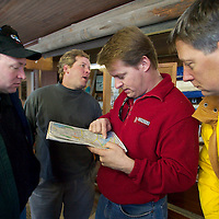(PSTORE) Red Bank 1/28/2004  Daniel Connell, Dave Clapp, Dan Clapp and Bob Hoder check out a Ocean County Map they consider heading south the Toms River where it better sailing ice was reported.  Michael J. Treola Staff Photographer