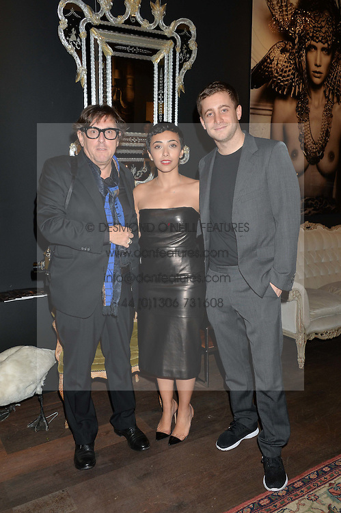 Left to right, MARC LAGRANGE, MASHAEL AL-RUSHAID and TYRONE WOOD at a private view of photographs by Marc Lagrange at Heist, 43 Linden Gardens, London on 2nd October 2014.