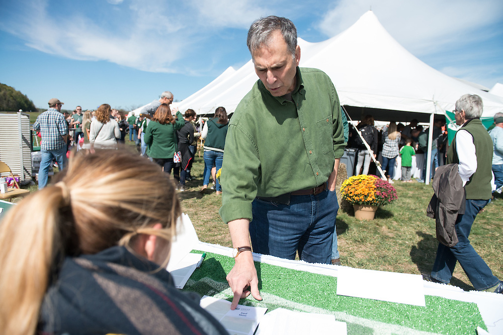 Paul Mass, Entrepreneur-in-residence for the Ohio University College of Business, registers during the homecoming tailgate party at Tailgreat Park on Saturday, October 8, 2016.