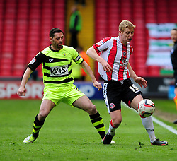Sheffield United's Barry Robson keeps the ball in under pressure from Yeovil Town's Jamie McAllister - Photo mandatory by-line: Dougie Allward/JMP - Tel: Mobile: 07966 386802 03/05/2013 - SPORT - FOOTBALL - Bramall Lane - Sheffield - Sheffield United V Yeovil Town - NPOWER LEAGUE ONE PLAY-OFF SEMI-FINAL FIRST LEG