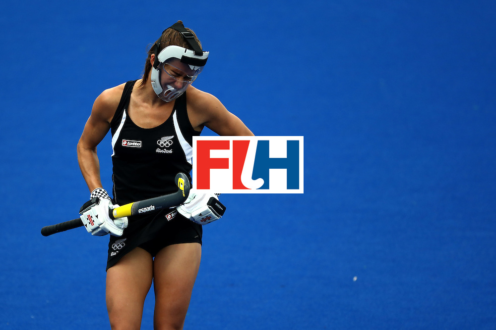 RIO DE JANEIRO, BRAZIL - AUGUST 12:  Petrea Webster #6 of New Zealand  grimaces after being hit by the ball against Netherlands during a Women's Preliminary Pool A match on Day 7 of the Rio 2016 Olympic Games at the Olympic Hockey Centre on August 12, 2016 in Rio de Janeiro, Brazil.  (Photo by Sean Haffey/Getty Images)