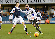 Bury midfielder Danny Mayor gets to the ball ahead of Millwall midfielder Shaun Williams during the Sky Bet League 1 match between Millwall and Bury at The Den, London, England on 28 November 2015. Photo by David Charbit.