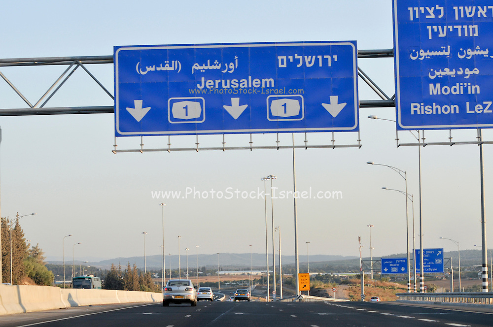 Israel, Highway 1 between Tel Aviv to Jerusalem. Marking signs towards Jerusalem in English, Hebrew and Arabic