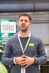 Asda Spokesperson Tim Scott addresses the gathering at the opening of FareShare's relocated warehouse in Ashford, Kent. Ashford, Kent, May 23 2019.