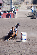Girls Barrel Racing, Ellensburg Rodeo. Ellensburg is the 2nd largest rodeo in the Pacfic Northwest and on the PCRA circuit. It occurs every Labor Day weekend, Ellensburg, Kittitas County, WA, USA. 2012 event.