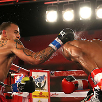Radivvoje Kalajdzic (L) punches  Larry Pryor during a Telemundo Boxeo boxing match at the A La Carte Pavilion on Friday,  March 13, 2015 in Tampa, Florida.  Kalajdzic  won the bout after the referee stopped the fight. (AP Photo/Alex Menendez)