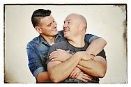 "PERTH, AUSTRALIA - MAY 31:  (L-R) Western Australian couple, Jason Griffiths, age 31 and Mark McCarthy age 43 pose during a portrait session on May 31, 2015 in Fremantle, Australia. Jason a Police Officer and Mark a Publican, have been in a defacto relationship for 10 years, never fight or argue and live in Collie, a South West regional town which can be quite discriminatory, support same-sex marriage. ""All for one...Equality !"", Mark said. The marriage equality debate in Australia has reignited on the back of Ireland's referendum legalising same-sex marriage last week. Recent polls suggest public support for gay marriage in Australia is at an all-time high of 72%.  (Photo by Paul Kane/Getty Images)"