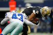 Dallas Cowboys free safety Gerald Sensabaugh (43) tackles New Orleans Saints running back Pierre Thomas (23) at Cowboys Stadium in Arlington, Texas, on December 23, 2012.  (Stan Olszewski/The Dallas Morning News)