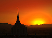 Rexburg,Idaho LDS Temple at Sunset on a September evening. Brillant Reds, Oranges,and Yellows provide the backdrop to frame the temple against the Upper Snake River Valley that it presides over.