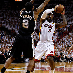 Jun 18, 2013; Miami, FL, USA; Miami Heat small forward LeBron James (6) looks to pass against San Antonio Spurs small forward Kawhi Leonard (2) during the first quarter of game six in the 2013 NBA Finals at American Airlines Arena.  Mandatory Credit: Derick E. Hingle-USA TODAY Sports