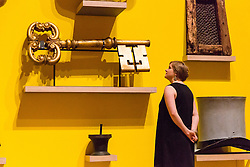 © Licensed to London News Pictures. 08/06/2014. London, UK. A woman looks at a large key at the British Folk Art exhibition at Tate Britain in Millbank, London on 8th June 2014. The British Folk Art exhibition at Tate Britain opens on 10th June 2014 and runs until 31st August 2014. Photo credit : Vickie Flores/LNP Photo credit : Vickie Flores/LNP