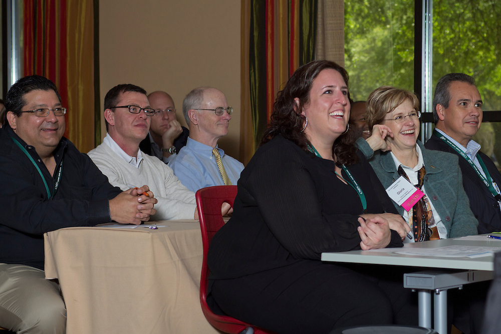 Audience members listen as HISD's Sue Robertson, Leo Bobadilla and Robert Sands present at the 2013 Council of Educational Facility Planners International Southern Region Conference about planning and passing a $1.89 billion bond referendum.<br />