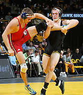 Iowa's Ethen Lofthouse takes down Southern Illinois Edwardsville's Michael Dace during the 174-pound bout of their dual at Carver-Hawkeye Arena, 1 Elliot Drive in Iowa City on Friday evening January 7, 2010. Lofthouse defeated Dace 14-7 and Iowa defeated Southern Illinois Edwardsville 49-0.