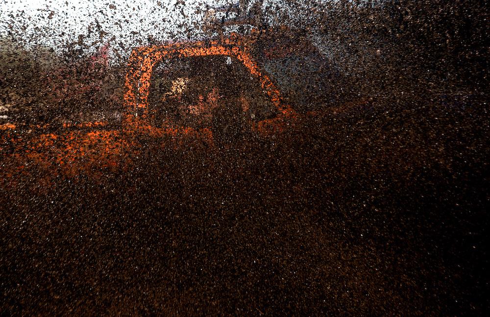Revelers splash through a mud pit at the Redneck Yacht Club in Punta Gorda, Fla. Photo by: Greg Kahn