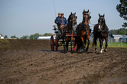 © London News Pictures. 12/05/2016. Windsor, UK. Horses wade through mud on the first day of the 2016 Royal Windsor Horse Show, held in the grounds of Windsor Castle in Berkshire, England. The opening day of the event was cancelled due to heavy rain and waterlogged grounds. This years event is part of HRH Queen Elizabeth II's 90th birthday celebrations.  Photo credit: Ben Cawthra/LNP
