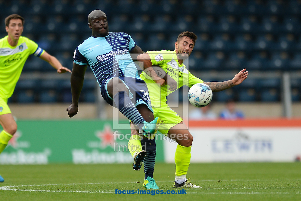 Adebayo Akinfenwa of Wycombe Wanderers does battle with Lewis Kinsella of Colchester United during the Sky Bet League 2 match between Wycombe Wanderers and Colchester United at Adams Park, High Wycombe<br /> Picture by Richard Blaxall/Focus Images Ltd +44 7853 364624<br /> 27/08/2016