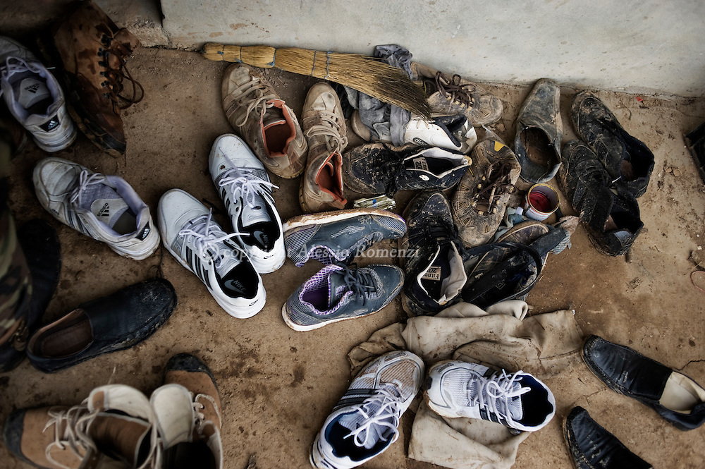 SYRIA - Homs province: Free Syrian Army soldiers shoes out of a house used as weapon deposit in the countryside of Homs on February 18, 2012. ALESSIO ROMENZI