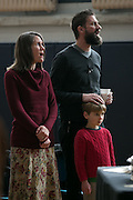 Pastor Chris Holdridge sings with his family during a service at the Community Place of Greater Rochester on Sunday, December 18, 2016.