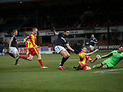 16th December 2017, Dens Park, Dundee, Scotland; Scottish Premier League football, Dundee versus Partick Thistle; Partick Thistle's Niall Keown blocks Dundee's Sofien Moussa's shot