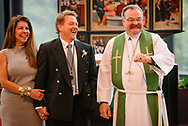 The Rev. Dr. Matthew Harrison, president of the LCMS, introduces the Rev. Dr. Gregory P. Seltz, executive director of the Lutheran Center for Religious Liberty, and his wife Marie Yvette, following a Service of Installation for Seltz at the International Center of The Lutheran Church–Missouri Synod on Tuesday, Aug. 22, 2017, in St. Louis. LCMS Communications/Erik M. Lunsford