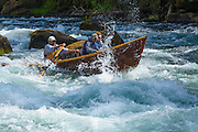 Guide Greg Hatten takes guests on his wooden drift boat through Marten Rapids on the McKenzie River, Oregon.