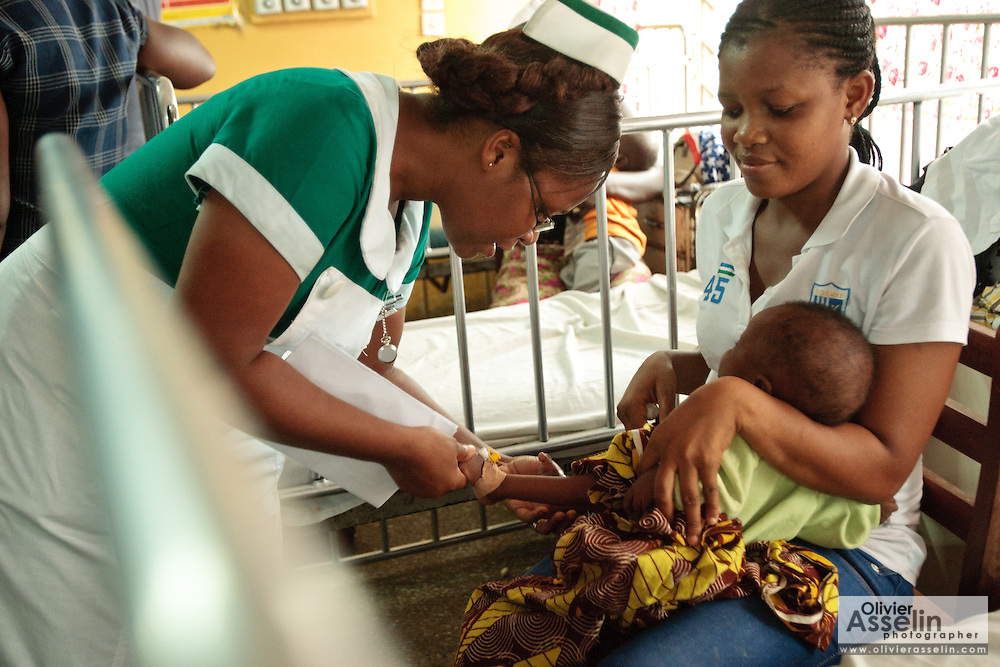 Ghana: 25 April 2012, A nurse examines a child at the Princess Marie Louise Children's hospital in Accra. The GAVI Alliance is a public-private partnership that brings together developing country and donor governments, WHO, UNICEF, the World Bank, the vaccine industry in both industrialised and developing countries, research and technical agencies, civil society, the Bill & Melinda Gates Foundation and other private philanthropists.  Set up in 2000 as the Global Alliance for Vaccines and Immunisation, GAVI's mission is to save children's lives and protect people's health by increasing access to immunisation in the world's poorest countries.