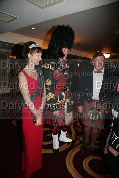 Iona, Duchess of Argyll, Pipe Major Stewart Paton and David Reid Chairman of Tesco. The Royal Caledonian Ball 2007. Grosvenor House. 4 May 2007.  -DO NOT ARCHIVE-© Copyright Photograph by Dafydd Jones. 248 Clapham Rd. London SW9 0PZ. Tel 0207 820 0771. www.dafjones.com.