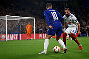 Mol Vidi defender Fiola Attila (5) tries to stop Chelsea FC forward Eden Hazard (10) getting in the box during the Europa League match between Chelsea and MOL Vidi at Stamford Bridge, London, England on 4 October 2018.