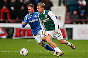 Hibernian FC Forward Jason Cummings on the attack against St Johnstones Chris Millar during the Scottish League Cup semi-final match between Hibernian and St Johnstone at Tynecastle Stadium, Gorgie, Scotland on 30 January 2016. Photo by Craig McAllister.