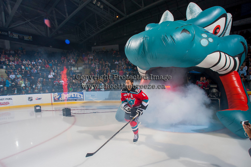 KELOWNA, CANADA - SEPTEMBER 21:  Madison Bowey #4 of the Kelowna Rockets enters the ice during the regular season home opener against the Kamloops Blazers at the Kelowna Rockets on September 21, 2013 at Prospera Place in Kelowna, British Columbia, Canada (Photo by Marissa Baecker/Shoot the Breeze) *** Local Caption ***
