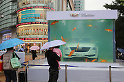 GUANGZHOU, CHINA - MARCH 21: (CHINA OUT) <br /> <br /> A luxury car immerses into a fish tank where carps swim around at Victoria Square in Tianhe District on March 21, 2016 in Guangzhou, Guangdong Province of China. The car brand claims it to be an installation art which has exhibited in Shanghai for two weeks last month. <br /> ©Exclusivepix Media