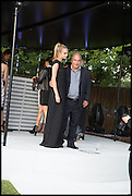 CARA DELEVIGNE; SIR PHILIP GREEN, 2014 Serpentine's summer party sponsored by Brioni.with a pavilion designed this year by Chilean architect Smiljan Radic  Kensington Gdns. London. 1July 2014