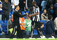 London - Wednesday September 22nd 2010: Newcastle Manager Chris Hughton shakes hands with goalscoring hero Shola Ameobi at the end of the Carling Cup 3rd Round match at Stamford Bridge, London. (Pic by Paul Chesterton/Focus Images)