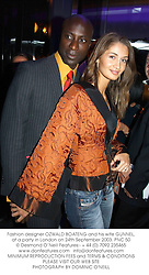Fashion designer OZWALD BOATENG and his wife GUNNEL, at a party in London on 24th September 2003.PNC 50