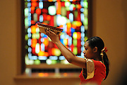 "Liturgical Dancer JaNiece Washington, 16, opens the 33rd Annual African American Heritage Month Eucharistic Celebration at Holy Name Cathedral. This year's mass celebrates the the Nguzo Saba principle of Kuumba, or ""creativity"" at Holy Name Cathedral."