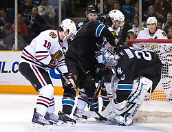 January 28, 2010; San Jose, CA, USA; San Jose Sharks goalie Evgeni Nabokov (20) makes a save in front of Chicago Blackhawks center Jonathan Toews (19) during the second period at HP Pavilion. Chicago defeated San Jose 4-3 in overtime. Mandatory Credit: Jason O. Watson / US PRESSWIRE