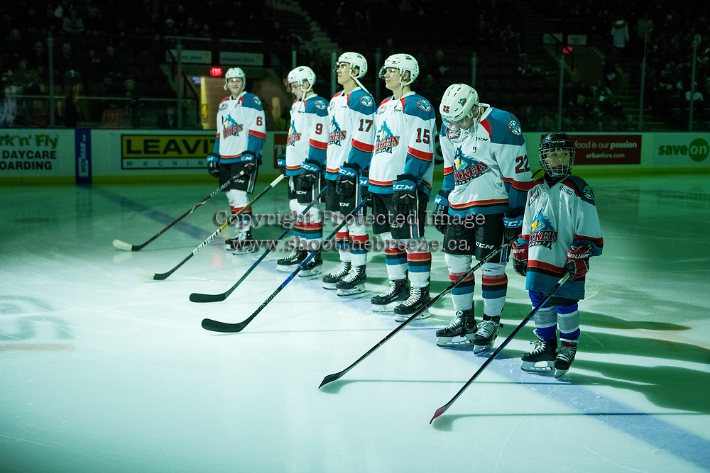 KELOWNA, CANADA - JANUARY 30:  Xander Griffiths the Pepsi Player of the game stands with the Kelowna Rockets' starting line up against the Seattle Thunderbirds on January 30, 2019 at Prospera Place in Kelowna, British Columbia, Canada.  (Photo by Marissa Baecker/Shoot the Breeze)