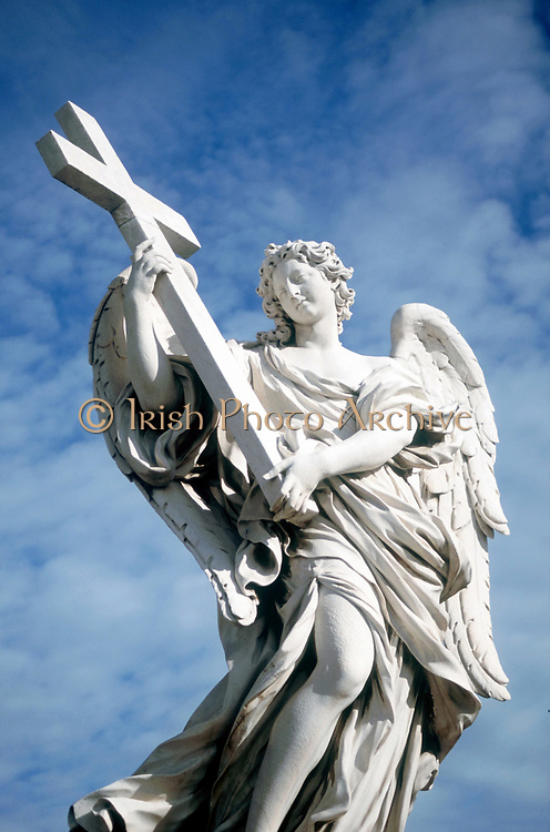 Angel carrying cross. From  bridge opposite Castel St Angelo, Rome, Italy.