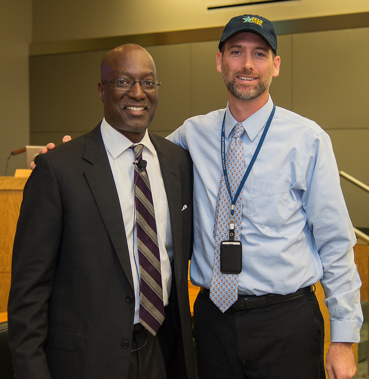 Houston ISD Interim Superintendent presents Mike Webb with a Team HISD cap during a central office staff meeting, May 17, 2016.