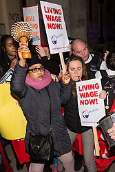 London, UK. 12th February, 2019. Police officers push members of grassroots trade union United Voices of the World protesting outside the Gadson Club in Pall Mall on the occasion of a reception with Justice Secretary David Gauke against his refusal to negotiate with the trade union over their demands for the London Living Wage, annual leave and sick pay for outsourced cleaners, security guards and receptionists working at the Ministry of Justice, all of whom have been on strike for varying periods recently. The Gadson Club is the official alumni club for the Oxford University Conservative Association.