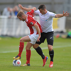 TELFORD COPYRIGHT MIKE SHERIDAN Aaron Williams of Telford battles for the ball with Connor Franklin during the National League North fixture between Brackley Town and AFC Telford United at St James's Park on Saturday, September 7, 2019<br /> <br /> Picture credit: Mike Sheridan<br /> <br /> MS201920-016
