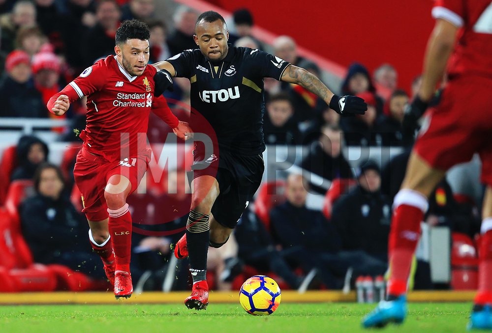 Alex Oxlade-Chamberlain of Liverpool takes on Jordan Ayew of Swansea City - Mandatory by-line: Matt McNulty/JMP - 26/12/2017 - FOOTBALL - Anfield - Liverpool, England - Liverpool v Swansea City - Premier League