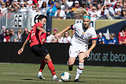 USA midfielder Julie Ertz (8) is defended by Korea Republic forward Son Kwayeon (22) during an international friendly soccer game in Chicago, Sunday, Oct. 6, 2019, in Chicago. The team splayed to a 1-1 tie. (Max Siker/Image of Sport)