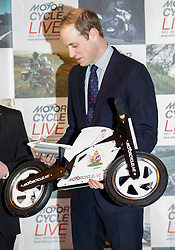 Prince William today attended the Motorbike Live Show at the N.E.C, Birmingham, United Kingdom. He toured the show, sitting on motorbikes. He was also presented with a special balance bike for Prince George. Saturday, 30th November 2013. Picture by i-Images
