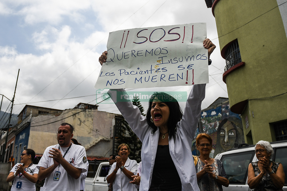 April 17, 2018 - Caracas, Venezuela - A protester seen holding up a placard during the demonstration..National protest in the health sector for lack of medicines and demanding an increase in salaries. The protest was called by the health association (FETRASALUD in spanish) at the national level. Doctors and staff working in hospitals protested in front of each health center demanding an immediate solution to the crisis affecting the public health system in Venezuela (Credit Image: © Roman Camacho/SOPA Images via ZUMA Wire)