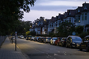 In the first light of dawn, cars are parked along a residential suburban street in south London, on 17th September 2020, in London, England.