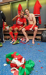 CARDIFF, WALES - Tuesday, October 13, 2015: Wales' captain Ashley Williams and Andy King celebrate in the dressing room after the 2-0 victory over Andorra, and qualification for the finals, following the UEFA Euro 2016 qualifying Group B match at the Cardiff City Stadium. (Pic by David Rawcliffe/Propaganda)