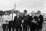 Harry Bradshaw and N.C. Lynch pose for a photograph with officials at the Irish Dunlop £1,000 Tournament at Tramore Golf Club, Co. Waterford on the 19th August 1967.