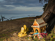 26 DECEMBER 2014 - MAE KHAO, PHUKET, THAILAND: A small shrine on the beach in Mae Khao, Phuket. The main morgue for people killed in the 2004 tsunami was near this shrine. Nearly 5400 people died on Thailand's Andaman during the 2004 Indian Ocean Tsunami that was spawned by an undersea earthquake off the Indonesian coast on Dec 26, 2004. In Thailand, many of the dead were tourists from Europe. More than 250,000 people were killed throughout the region, from Thailand to Kenya. There are memorial services across the Thai Andaman coast this weekend.    PHOTO BY JACK KURTZ